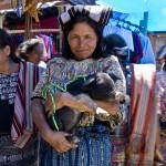 Cotzal market woman proud of piglet